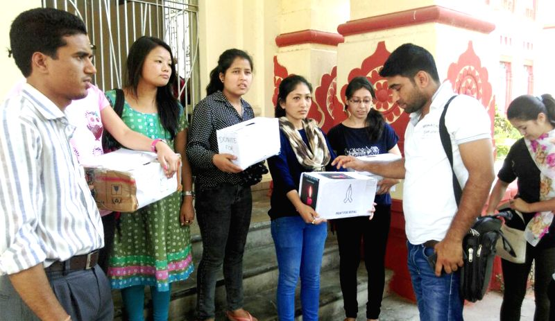 Nepali students of Banaras Hindu University collect donations for the victims of Nepal earthquake outside BHU campus in Varanasi on April 30, 2015.