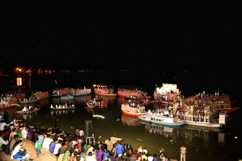 People participate in `Burwa Mangal` organised on the banks of Ganga at Assi Ghat in Varanasi, on March 17, 2015.
