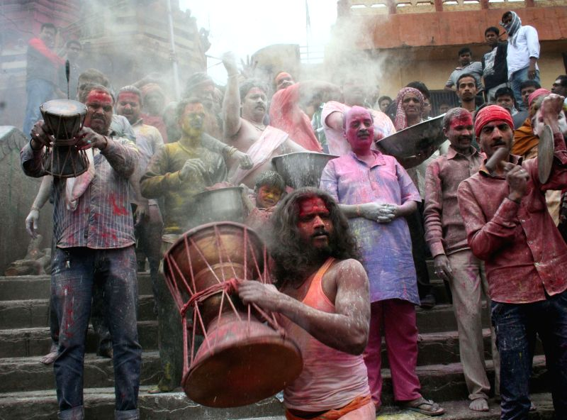 People play holi with `chita bhasm` or ash of dead body at the Manikarnika Ghat in Varanasi on March 3, 2015.