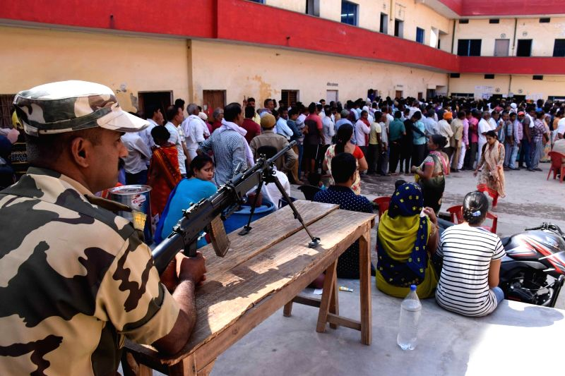 Varanasi: People queue-up to cast their votes during the seventh and the last phase of 2019 Lok Sabha Elections at a polling booth in Varanasi on May 19, 2019.