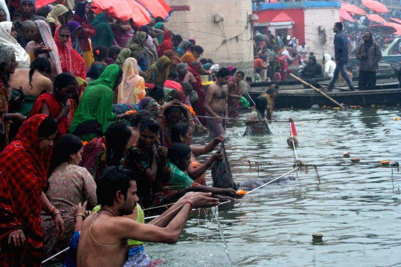 People take holy dip in the Ganga river on Mauni Amavasya in Varanasi, on Jan 20, 2015.
