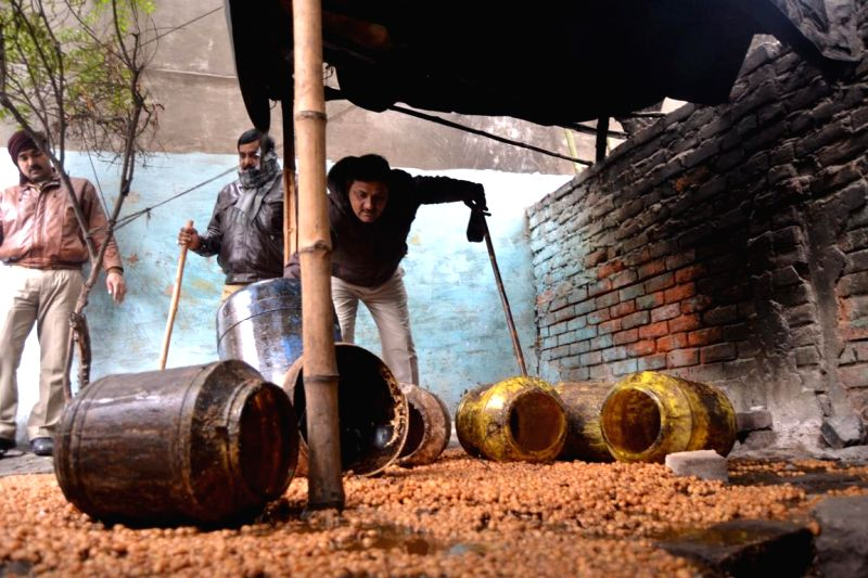 Police bust shacks manufacturing illicit liquor in Varanasi on Jan 13, 2015.