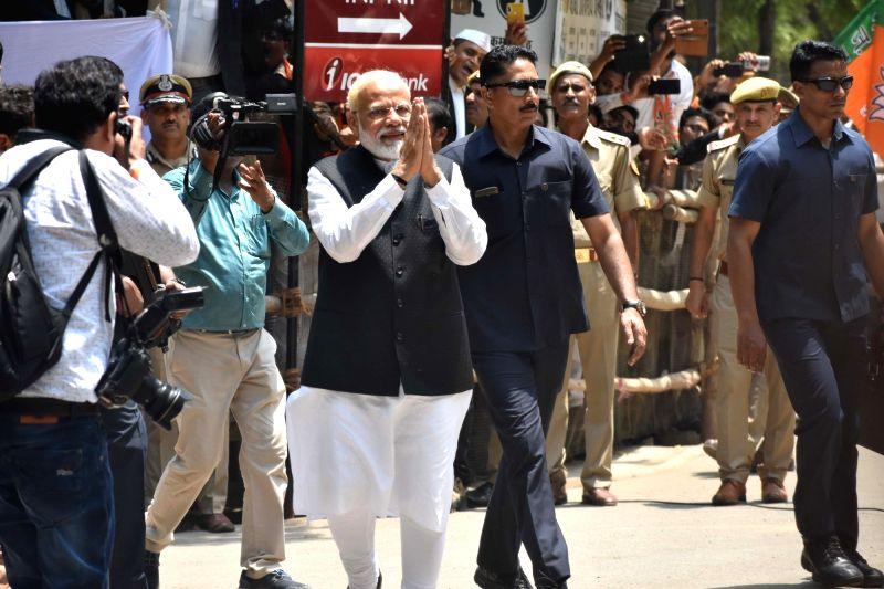 Varanasi: Prime Minister and BJP's Lok Sabha candidate from Varanasi, Narendra Modi arrives to file his nomination for the forthcoming Lok Sabha elections, in Varanasi on April 26, 2019.
