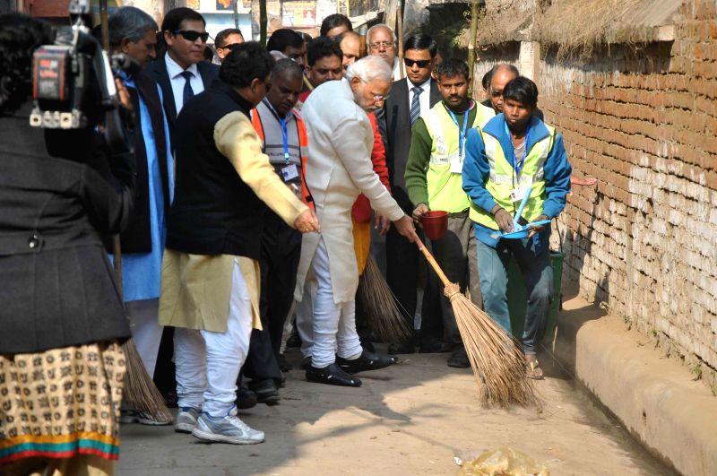 Prime Minister Narendra Modi participates in Clean India Campaign in Varanasi, on Dec 25, 2014. - Narendra Modi