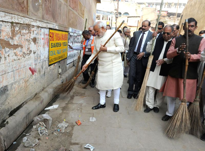 Prime Minister Narendra Modi participating in a cleanliness drive, at Jagannath Gali near Assi Ghat, in Varanasi, Uttar Pradesh on Dec 25, 2014. - Narendra Modi