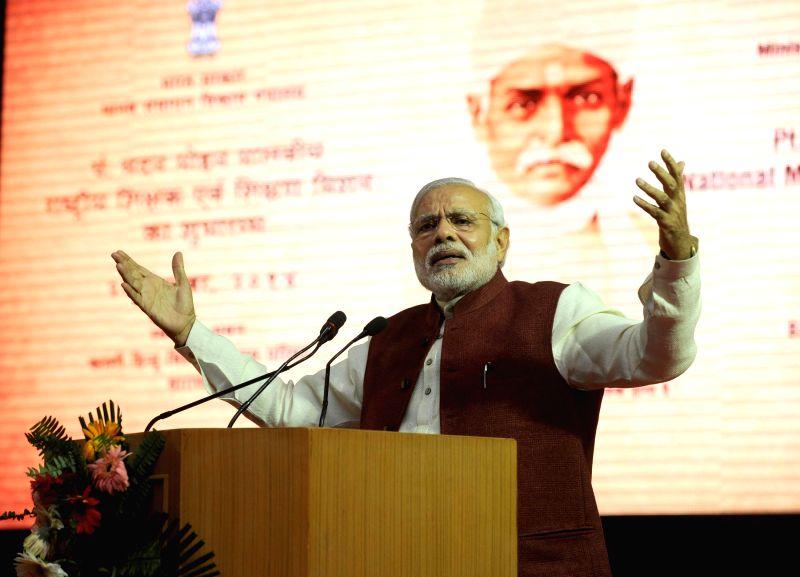 Prime Minister Narendra Modi addresses at Banaras Hindu University at the launch of the Madan Mohan Malviya National Mission on Teachers and Teaching, in Varanasi, Uttar Pradesh on Dec 25, . - Narendra Modi