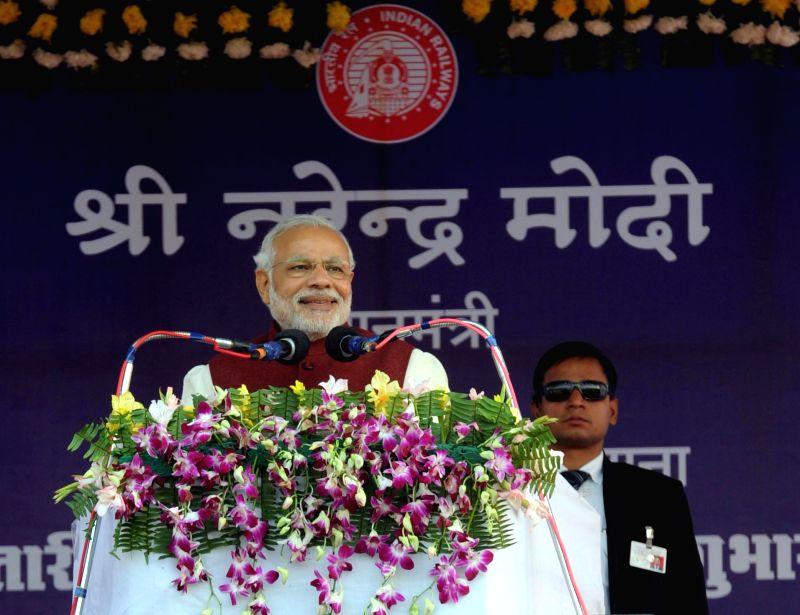 Prime Minister Narendra Modi addresses at the inauguration of the expanded Diesel Locomotive Works (DLW), in Varanasi, Uttar Pradesh on Dec 25, 2014. - Narendra Modi