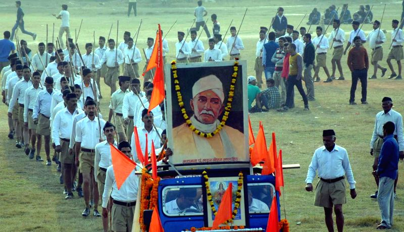 RSS volunteers participate in a march organised on the foundation day of Banaras Hindu University in Varanasi, on Jan 25, 2015.