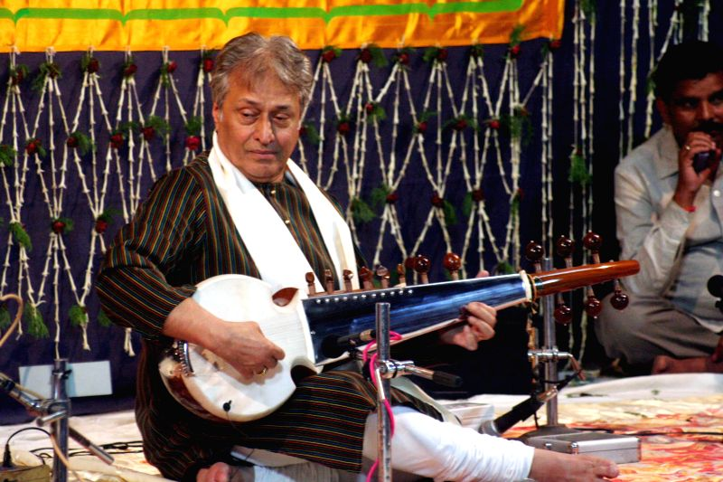 Sarod player Ustad Amjad Ali Khan performs during the Sankat Mochan Sangeet Samaroh in Varanasi on April 8, 2015.