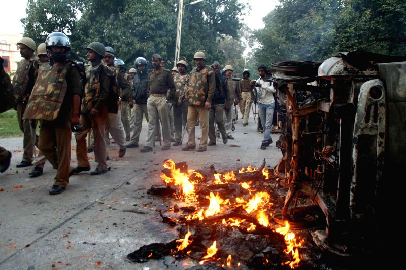 Students set car on fire as clash with police during a protest at Banaras Hindu University (BHU) campus in Varanasi on Nov. 20, 2014.