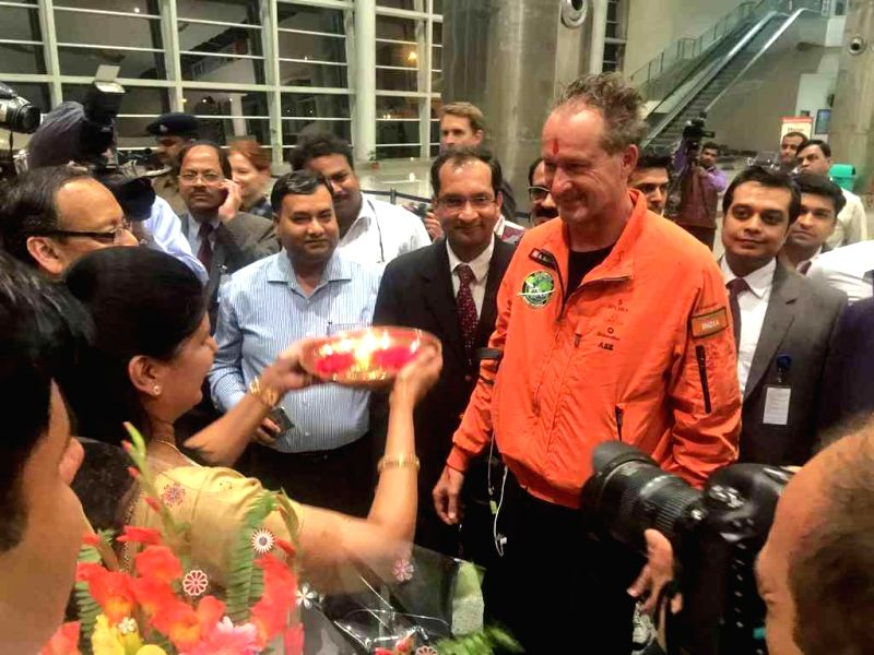 Swiss pilot and founder of co-founder of the Solar Impulse project, Andre Boschberg being welcomed in Varanasi on March 18, 2015.