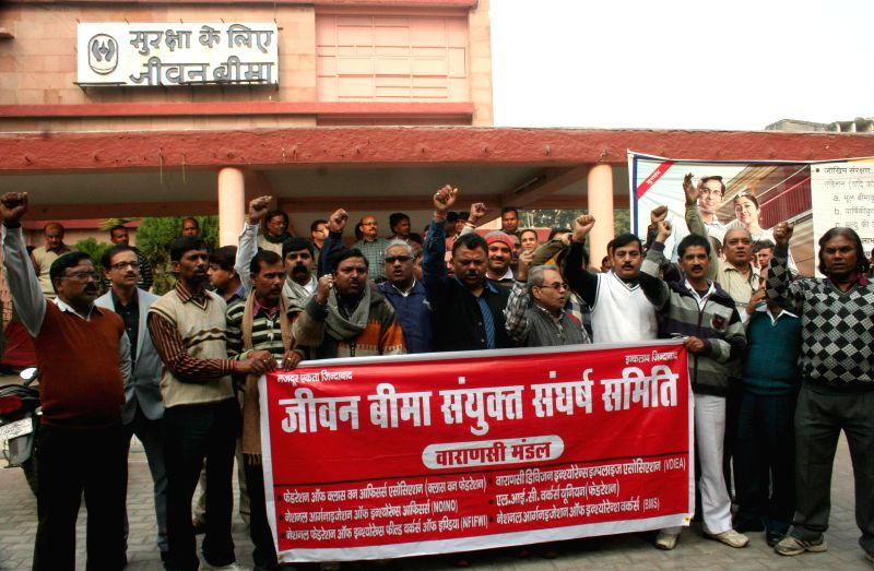 The employees of Life Insurance Corporation of India stage a demonstration against FDI in insurance sector  in Varanasi on Dec 5, 2014.