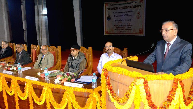 The Vice-chancellor of Banaras Hindu University (BHU) Girish Chandra Tripathi addresses during an international conference on `Frontiers of Spectroscopy` in Varanasi, on Jan 10, 2015. - Girish Chandra Tripathi