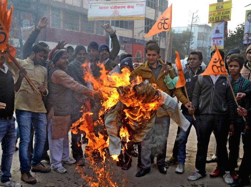 Vishwa Hindu Parishad (VHP) workers stage a demonstration  outside a theater screening Aamir Khan starrer `PK` in Varanasi on Dec 30, 2014. - Aamir Khan