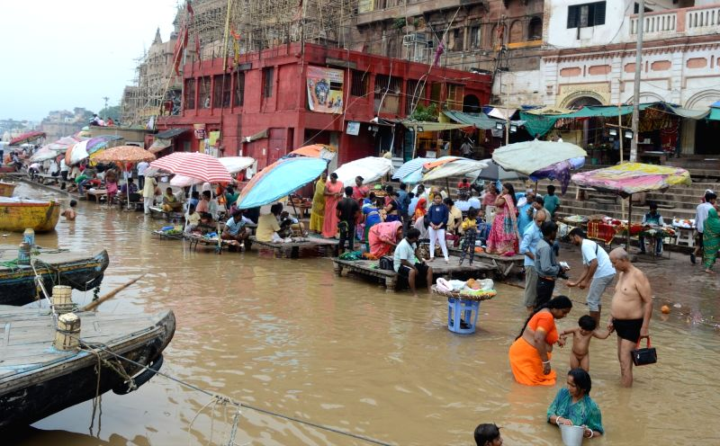 Varanasi: Water level rises in Ganga river in Varanasi on Aug 7, 2019.