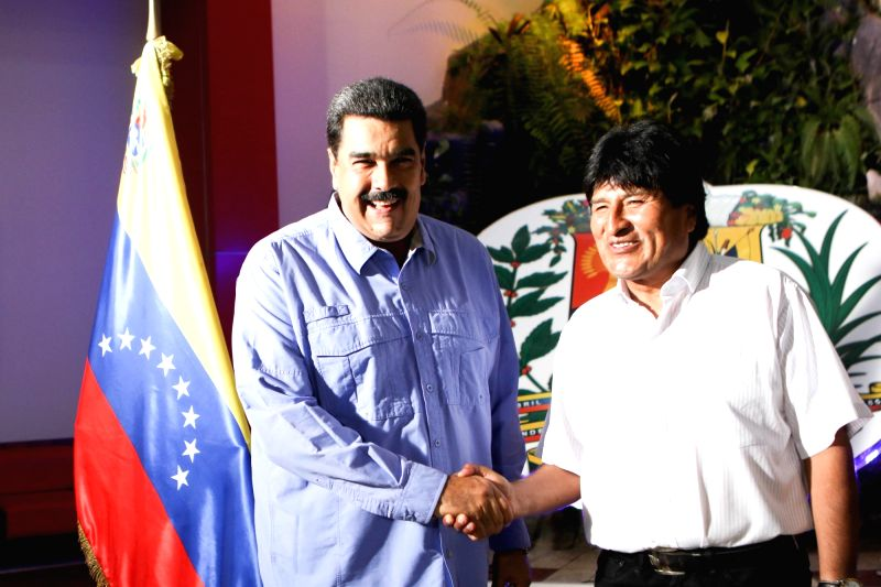 VARGAS, May 22, 2016 - Photo provided by Venezuela's Presidency shows Venezuelan President Nicolas Maduro (L) meeting with his Bolivian counterpart Evo Morales at Simon Bolivar International Airport ...