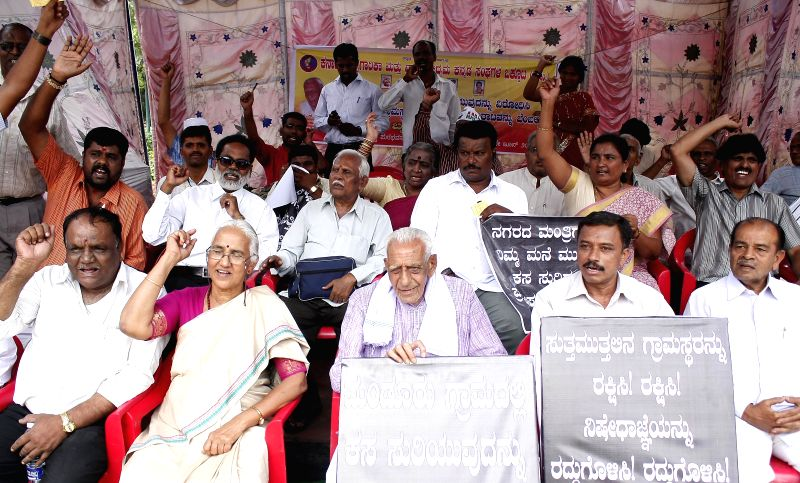Various Kannada organizations led by Freedom Fighter HS Doreswamy protesting against garbage dumping in Madoor village, in Bangalore on June 16, 2014.