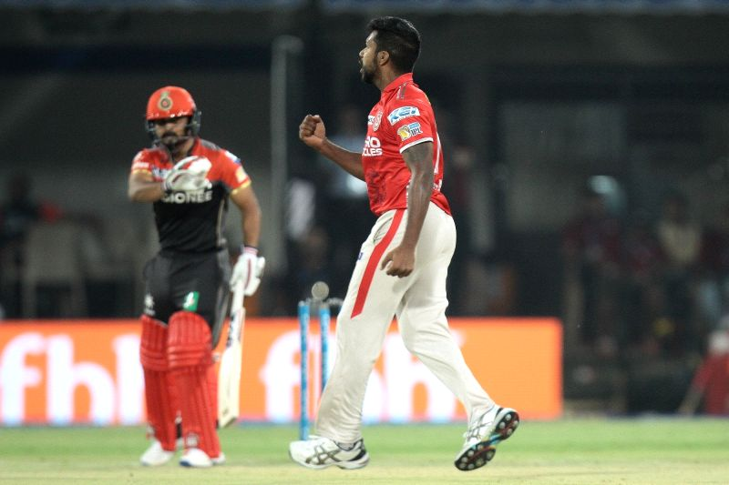 Varun Aaron of Kings XI Punjab celebrates fall of a wicket during an IPL 2017 match between Kings XI Punjab and Royal Challengers Bangalore at Holkar Cricket Stadium in Indore on April 10, ...