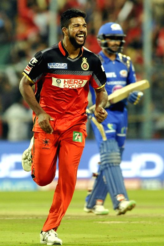 Varun Aaron of Royal Challengers Bangalore celebrates fall of a wicket during an IPL match between Royal Challengers Bangalore and Mumbai Indians at M Chinnaswamy Stadium in Bengaluru, on ...