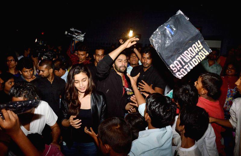 Varun Dhawan and Alia Bhatt visit theatres to meet their fans.