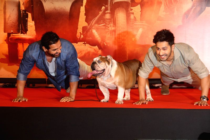 Varun Dhawan and John Abraham during a media interaction for success of the film Dishoom in Mumbai on August 3, 2016 - John Abraham