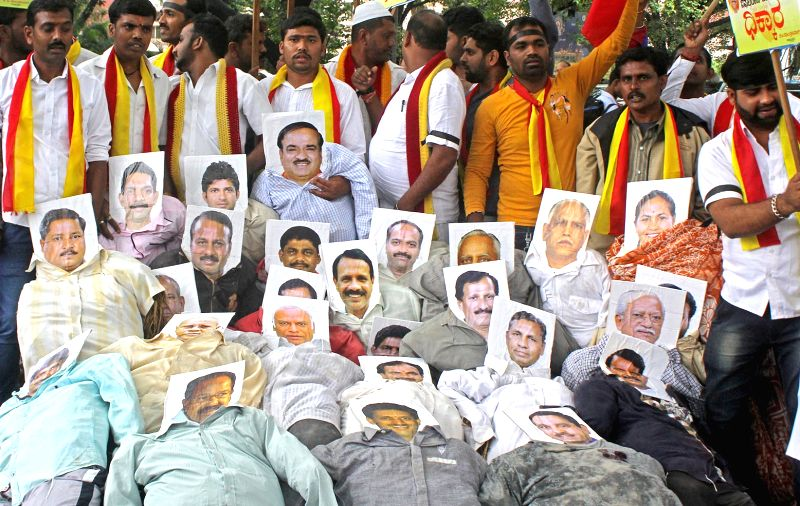 Veera Kannadigara Sene members stage a demonstration against verdict on Mahadayi water project, in Bengaluru on July 29, 2016.