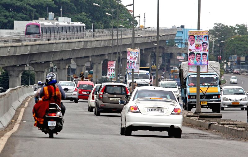 Vehicles ply on Bengaluru roads during the Karnataka shutdown call given by the Federation of Kannada Associations on June 12, 2017. Government and private schools, colleges, hotels and ...