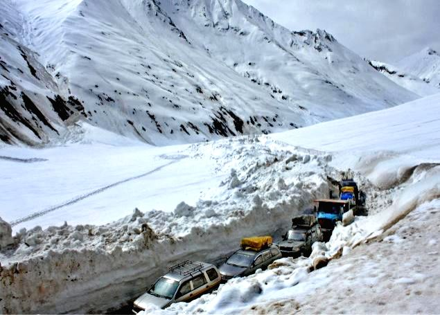 Vehicles ply on Srinagar - Ladakh highway which was thrown open for vehicular movement on May 11, 2014.