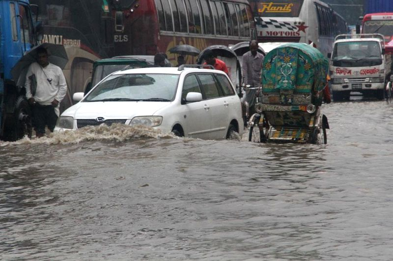 Vehicles ply on water logged streets of Chittagong's Muradpur in Bangladesh on June 20, 2014.