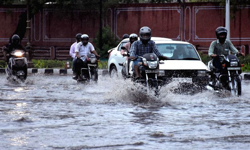 Vehicles ply on water logged streets of Jaipur, on May 31, 2017.