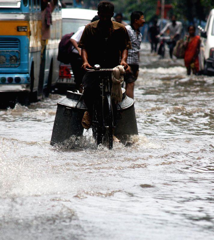 Vehicles ply on waterlogged roads of Kolkata after rains on July 1, 2014.