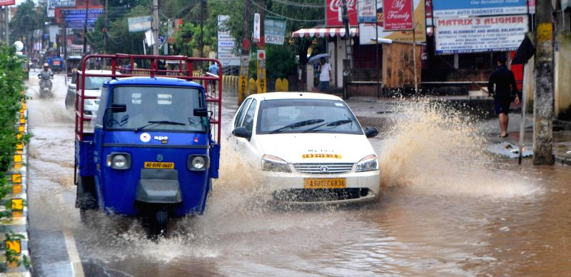 Vehicles ply on waterlogged Zoo Road in Guwahati on June 22, 2014.