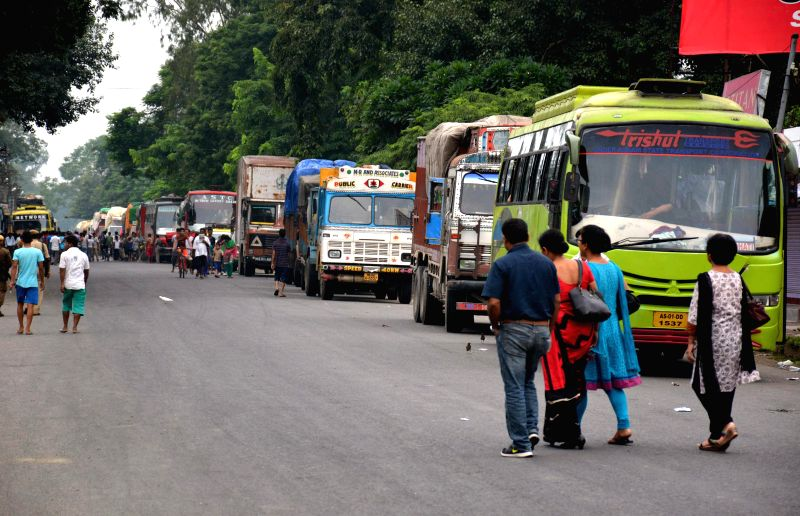 Vehicles remain stranded on National Highway 37 in Bokakhat during Assam bandh called by various organisations against police atrocities on Aug 21, 2014.