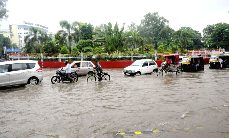 Vehicles struggle through waterlogged roads of Patna after heavy rains on Aug 13, 2014.