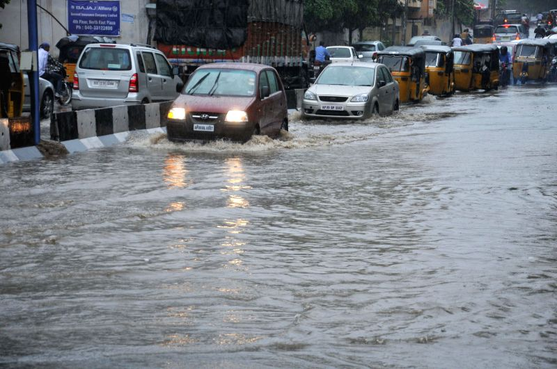 Vehicles struggle through waterlogged roads of Hyderabad after heavy rains lashed the city on Aug 31, 2014.