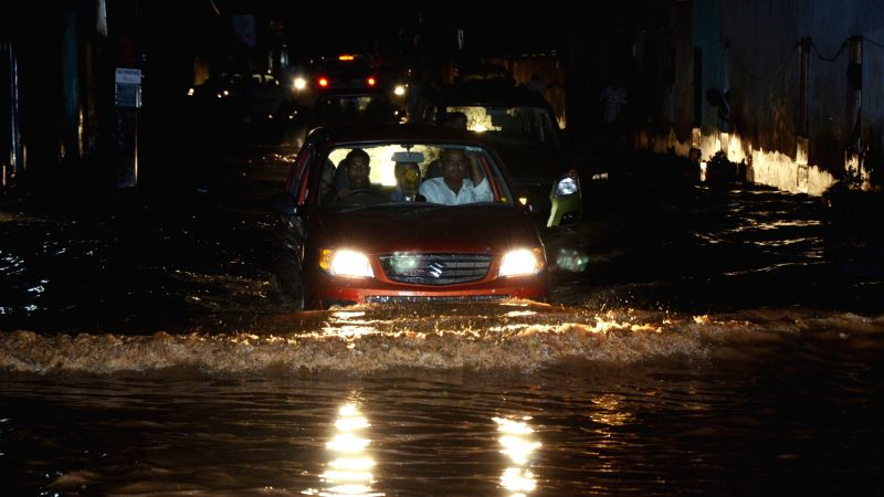 Vehicles vehicle ply on water logged roads of Guwahati on July 19, 2016.