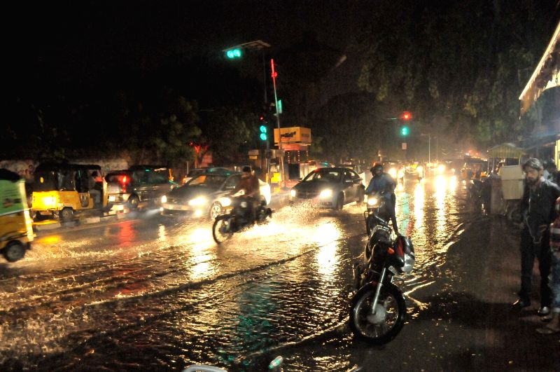 Vehicles wade through waterlogged streets of Hyderabad on Aug 12, 2017.