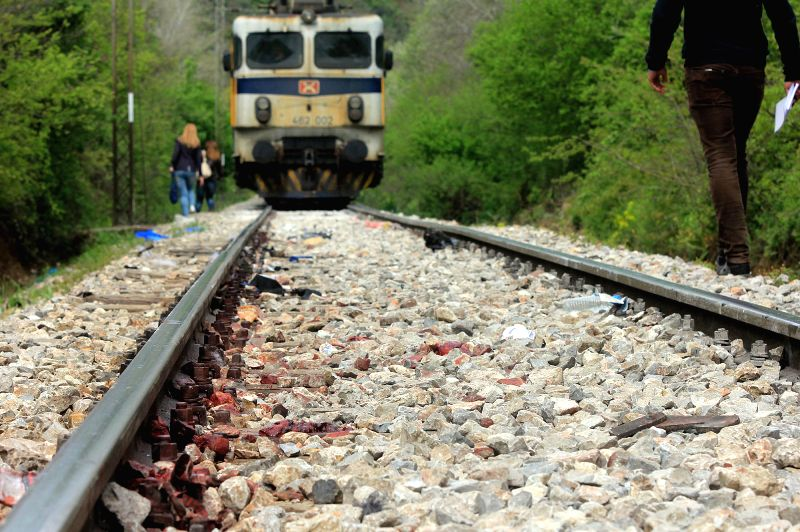 Photo taken on April 24, 2015 shows the scene of a train accident in Veles, Macedonia. At least 14 illegal immigrants were killed in a train accident late Thursday ...
