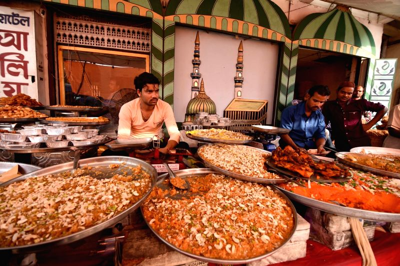 Vendors sell food at a roadside shop during Ramadan in Guwahati on June 1, 2017.
