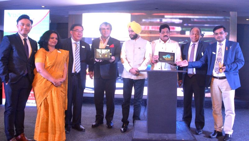 "Venezuelan Ambassador to India Augusto Montiel with Josh President Sunita Gupta and Alco International MD Yick Ka Lei at the launch of ""Venturer LapTAB"" in New Delhi on May 16, ... - Sunita Gupta"