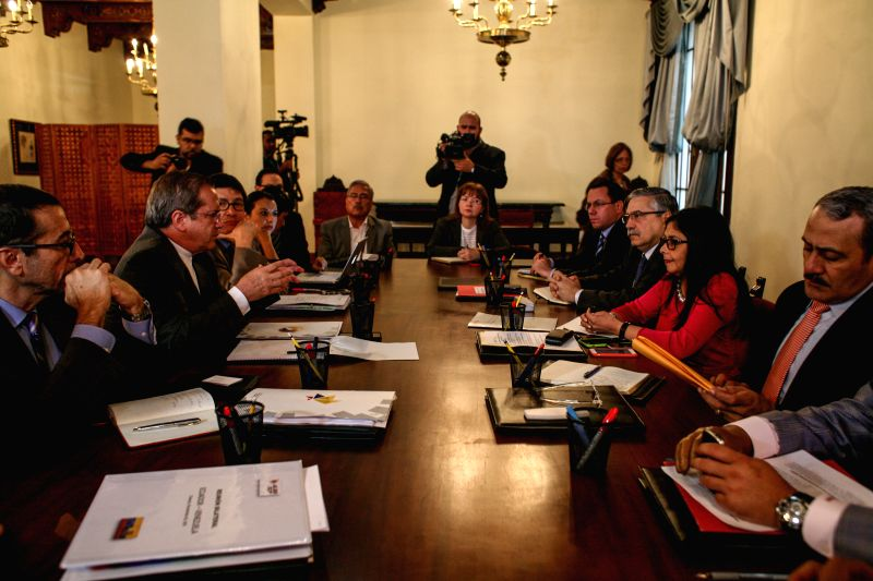 Venezuelan Foreign Minister Delcy Rodriguez (2nd R) and her Ecuadorian counterpart Ricardo Patino (2nd L) hold a meeting at the Chancellery in Caracas, Venezuela, ... - Delcy Rodriguez