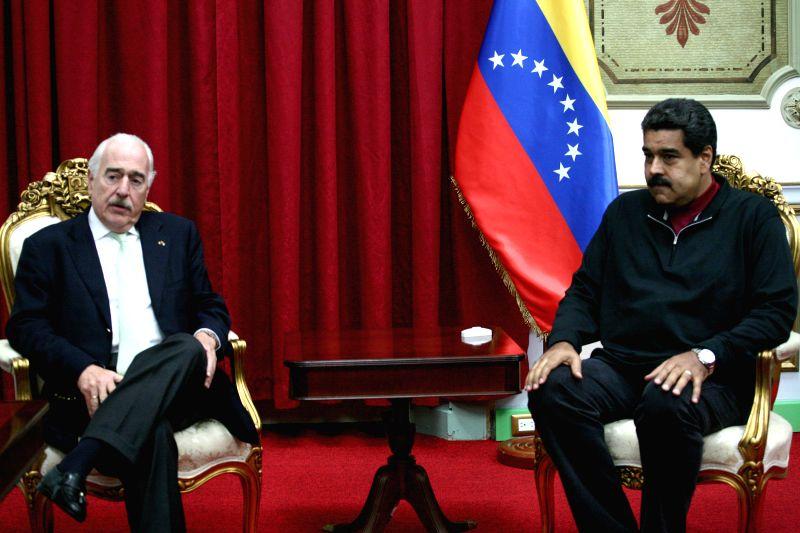 Venezuelan President Nicolas Maduro (R) meets with former Colombian President Andres Pastrana in Miraflores Palace, in Caracas, Venezuela, on Dec. 5, 2015.  ...