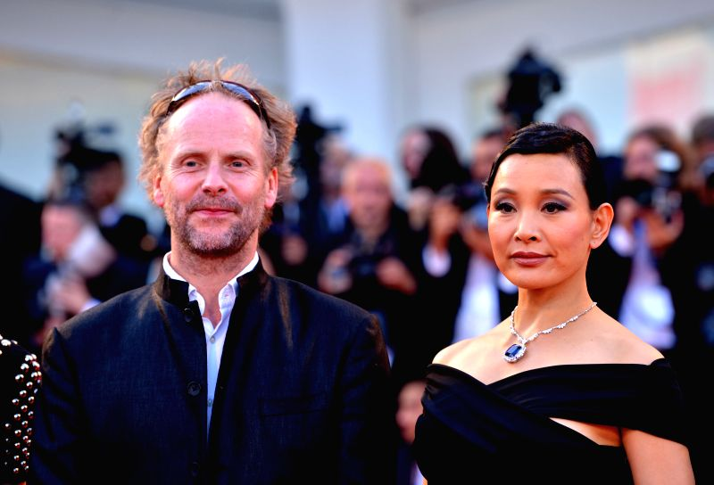 """Member of Jury Joan Chen (R) poses on the red carpet during the """"Birdman"""" premiere and the opening ceremony of the 71st Venice International Film Festival ."""