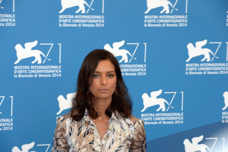 Member of the international jury of Main Competition Jhumpa Lahiri poses during a photo call for the 71st Venice Film Festival Aug. 27, 2014.