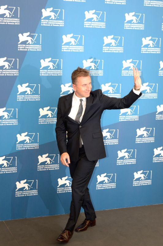 Member of the international jury of Main Competition Tim Roth poses during a photo call for the 71st Venice Film Festival Aug. 27, 2014.