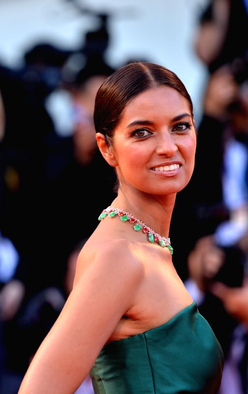 """Member of the jury Jhumpa Lahiri poses on the red carpet during the """"Birdman"""" premiere and the opening ceremony of the 71st Venice International Film ..."""