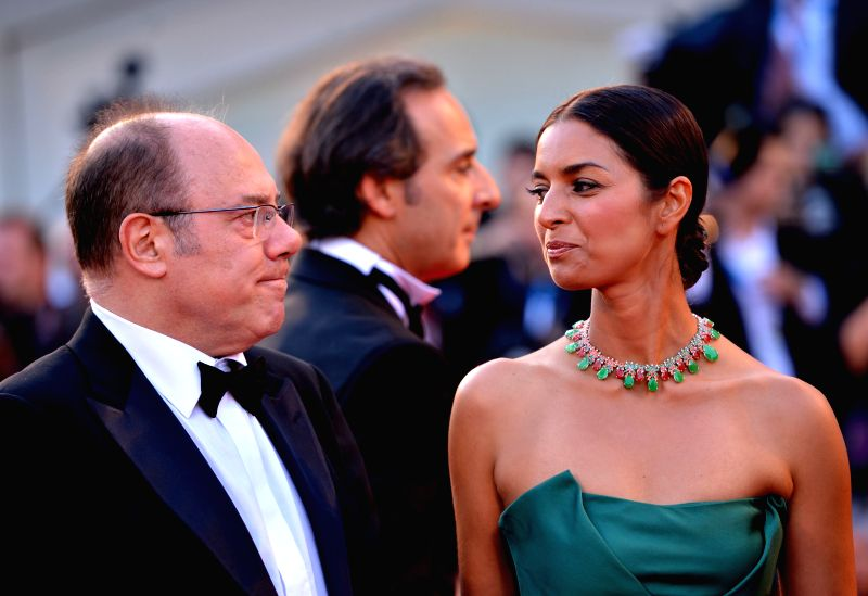 """Members of the jury Jhumpa Lahiri (R) and Carlo Verdone arrive for the red carpet during the """"Birdman"""" premiere and the opening ceremony of the 71st ..."""
