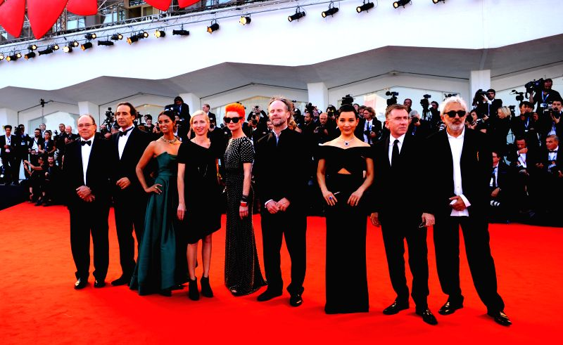 Members of the jury pose on the red carpet during the opening ceremony of the 71st Venice International Film Festival on the Lido island of Venice, Italy, Aug. 27, .