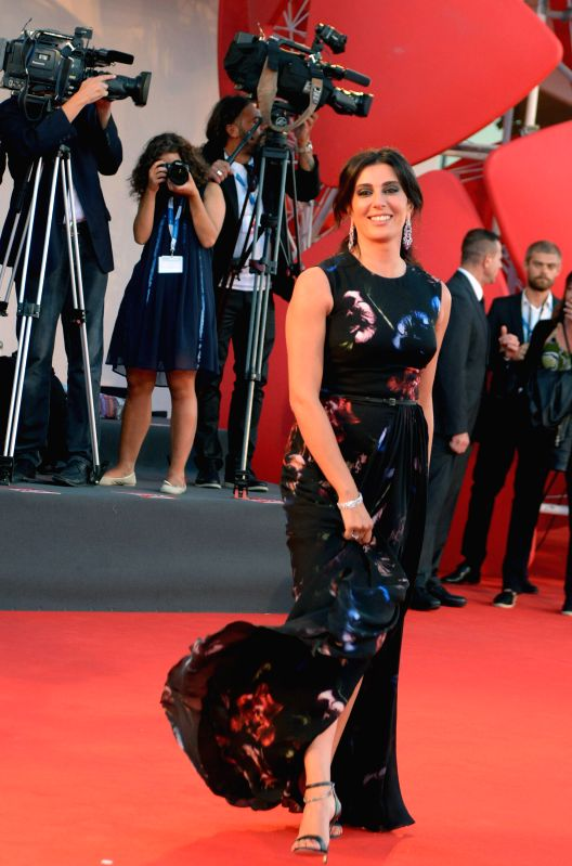 "Actress Nadine Labaki poses on the red carpet for the selected film for main competition ""La Rancon de La Gloire"" during the 71st Venice Film Festival, in . - Nadine Labaki"