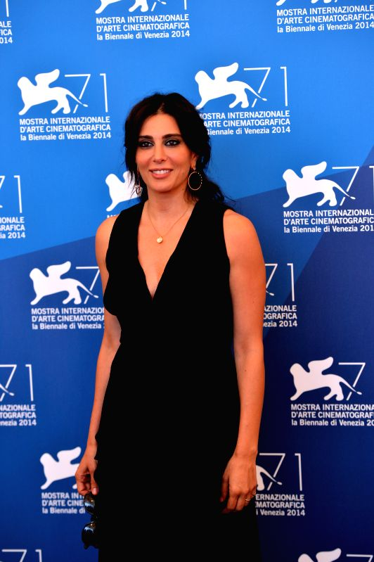 "Actress Nadine Labaki poses during the photocall for the selected film for main competition ""La Rancon de La Gloire"" during the 71st Venice Film Festival, . - Nadine Labaki"
